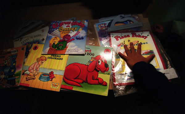 A young reader reaches for a book; nearly $450,000 was granted to local literacy programs in 2012 as a result of the Los Angeles Times Holiday Campaign.