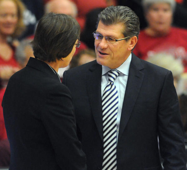 UConn head coach Geno Auriemma, right, exchanges pleasantries with Stanford head coach Tara VanDerveer at Roscoe Maples Pavilion before Saturday afternoon's game.