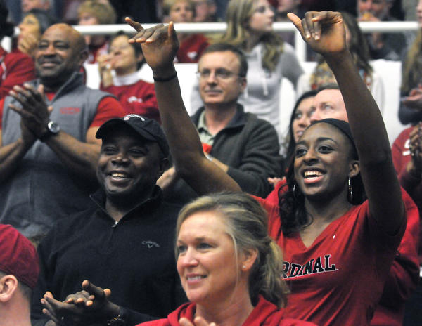 Former Stanford standout Nneka Ogwumike, right, cheers on her sister Chiney and her former teammates at Roscoe Maples Pavilion Saturday afternoon. Nneka, now a forward for the Los Angeles Sparks, was named 2012 WNBA rookie of the year.