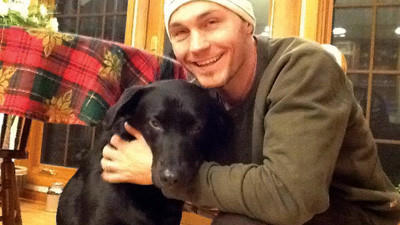 Christopher Hart and his dog, Diesel