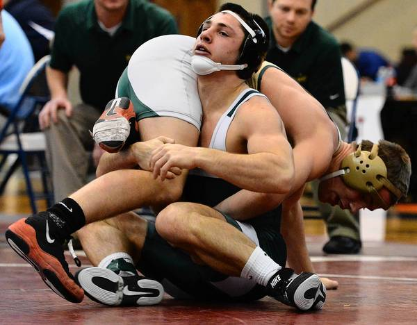 Pen Argyl's Mikey Racciato (front) wrestles St. Mark's Daniel Downes in the 146 lbs. weight class during the finals of the Bethlehem Holiday Wrestling Classic at Liberty High School on Saturday .