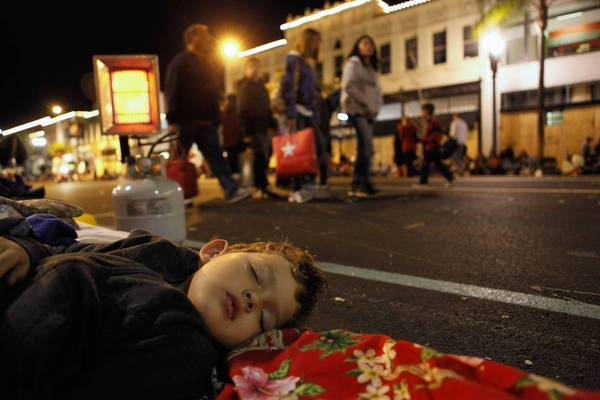 Ian Day gets some sleep on Colorado Boulevard in Pasadena the night before the 123rd Rose Parade in 2012.