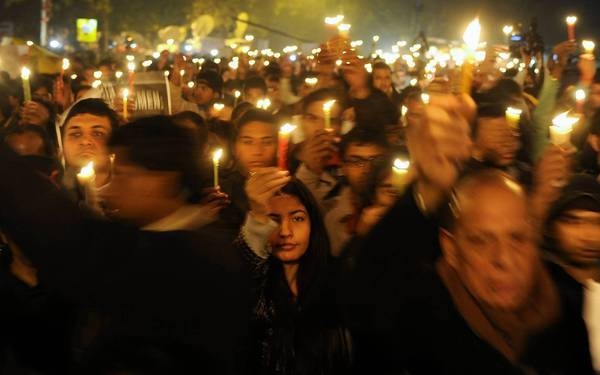 Protesters gather for a rally in New Delhi late Saturday after the death of a victim of gang rape.