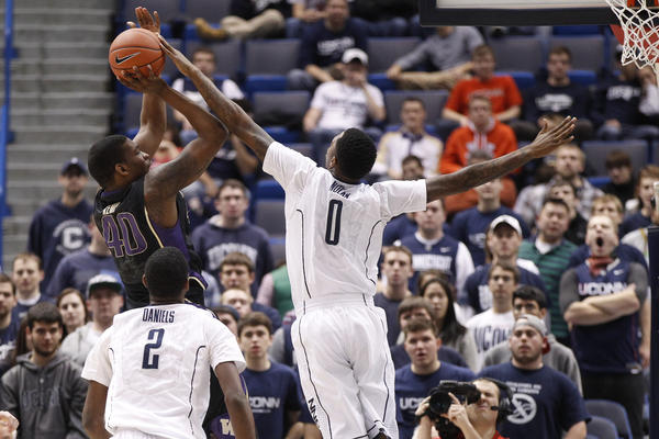 UConn forward Phillip Nolan blocks the shot of Washington Huskies forward Shawn Kemp Jr. during the second half.
