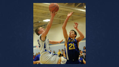 Berlins Steve Lotinsky puts up a shot over Northern defender Tyler Yutzy (21) in the consolation game of the Berlin Basketball Boosters Holiday Tournament Saturday afternoon.