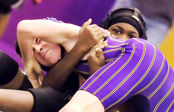 Smithsburg's Dylan Bryce, left, gains an edge over Milford Mill's Hassien Brockington in a 113-pound match Saturday at the Leopard Holiday Invitational. Bryce won the bout by pin.