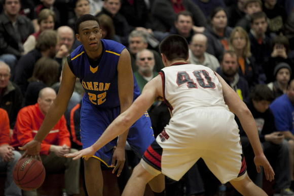 West Aurora senior Spencer Thomas guards Simeon senior Jabari Parker during the fourth quarter at the 82nd Pontiac Holiday Tournament at Pontiac High School .