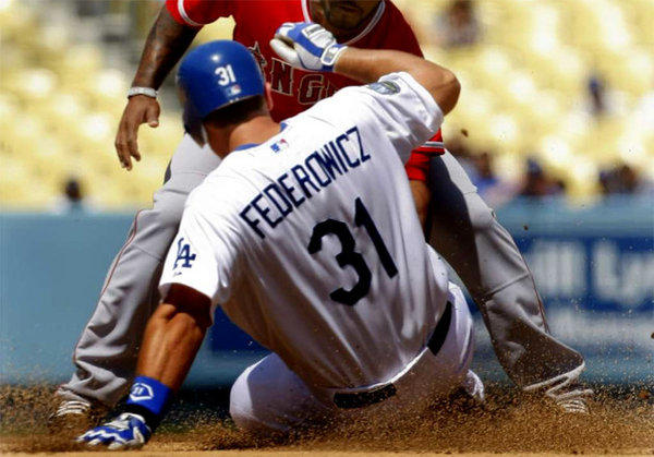 Tim Federowicz was caught trying to steal during the second inning of the final game of the Freeway Series at Dodger Stadium.