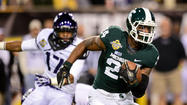 TEMPE, Ariz. -- Senior Dan Conroy made a 47-yard field goal with 1:01 remaining and junior halfback LeVeon Bell rushed for 145 yards and a touchdown to lead Michigan State to a comeback 17-16 victory over TCU in the inaugural Buffalo Wild Wings Bowl at Sun Devil Stadium.