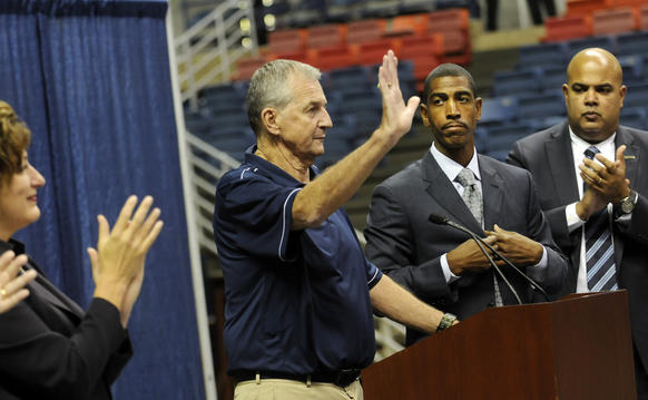 UConn head basketball coach Jim Calhoun announced his retirement after 26 years as head coach at a press conference in Gampel Pavilion Thursday. After speaking, Calhoun waved to the crowd with, left to right: UConn President Susan Herbst, new head coach Kevin Ollie and Warde Manuel, Director of Athletics.
