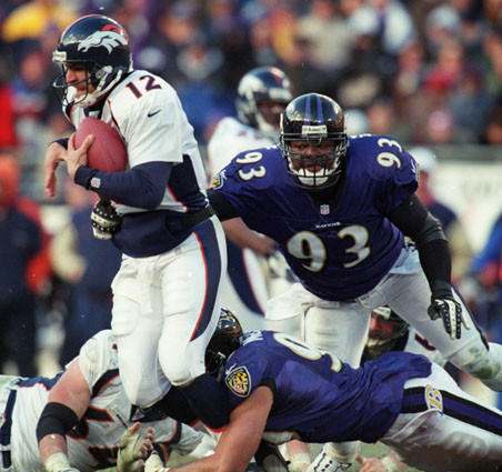 Michael McCrary sacks Broncos QB Gus Frerotte as Keith Washington converges on the play.