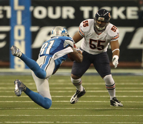Lions wide receiver Calvin Johnson (81) makes a catch in front of linebacker Lance Briggs during the first quarter.