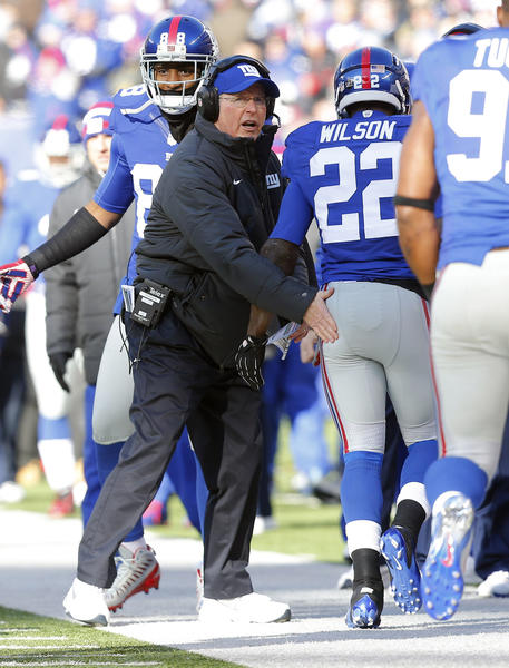 New York Giants head coach Tom Coughlin congratulates running back David Wilson (22) after touchdown against the Philadelphia Eagles during the first half at MetLife Stadium.