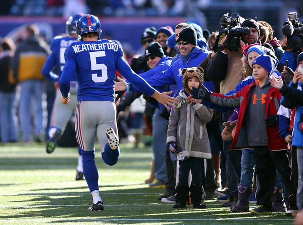 Giants player Steve Weatherford greets members of the Sandy Hook Elementary School community on the field prior to the start of the Giants-Eagles game on Sunday.