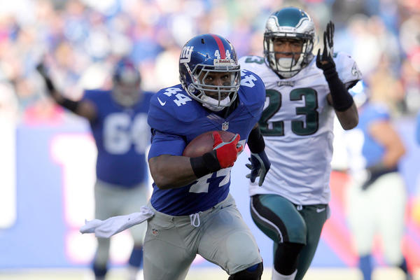 New York Giants running back Ahmad Bradshaw (44) is chased by Philadelphia Eagles corner back Dominique Rodgers-Cromartie (23) during the first quarter of an NFL game at MetLife Stadium.