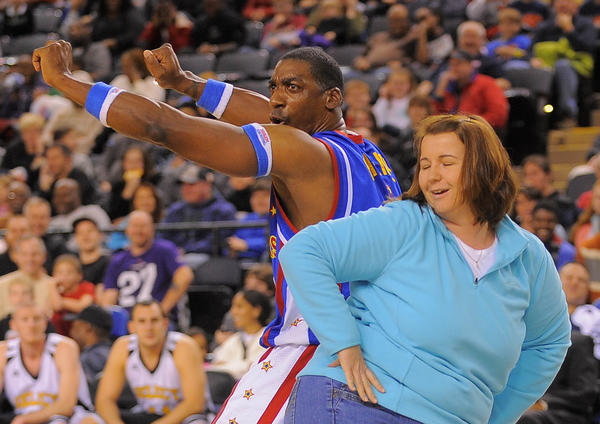 Hi-Lite of the Harlem Globetrotters dances with Loretta Grieves of Westminster during their performance Saturday at 1st Mariner Arena.