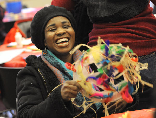 Chakeesha Simmons-El of Baltimore has fun as she makes an African Mask during a Kwanzaa celebration. The annual celebration of African heritage, focusing on the seven core principals of unity, self-determination, collective work and responsibility, cooperative economics, purpose, creativity, and faith was marked with a festival on Saturday at the Reginald F. Lewis Museum of Maryland African American History and Culture.