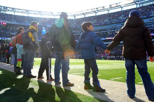 Members of the Sandy Hook Elementary community rings the field prior to the start of the Giants-Eagles game on Sunday.