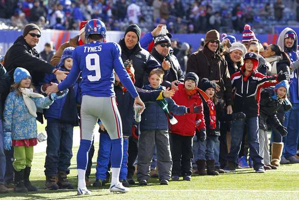 Giants kicker Lawrence Tynes greets members of the Sandy Hook Elementary community prior to the start of the Giants-Eagles game on Sunday.