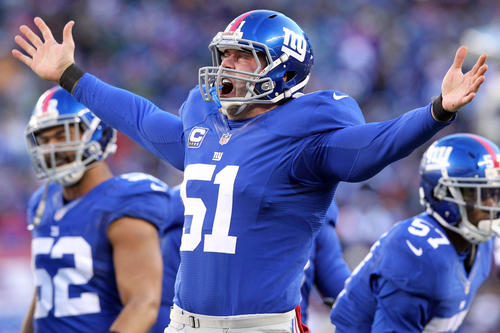 New York Giants long snapper Zak DeOssie (51) reacts after making a tackle against the Philadelphia Eagles during the third quarter of an NFL game at MetLife Stadium.