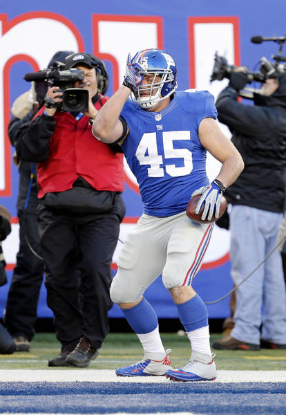 New York Giants fullback Henry Hynoski (45) celebrates after scoring a touchdown against the Philadelphia Eagles during the game at Metlife Stadium.