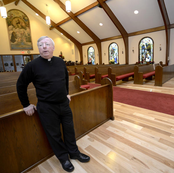 Rev. George Pucciarelli in St. Bernadette Catholic Church's new sanctuary in Hedgesville.