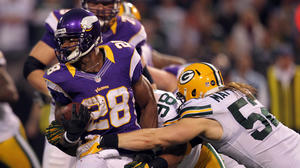 Vikings edge Packers to earn playoff berth, eliminate Bears