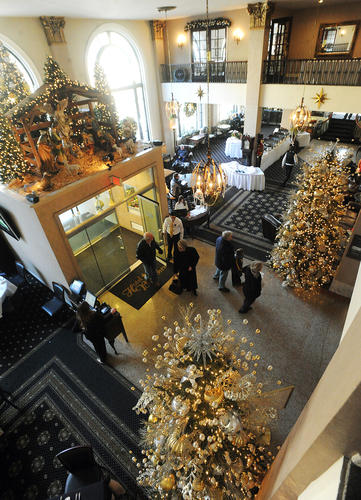 Visitors walk through the decorated main lobby at the Historic Hotel Bethlehem Friday afternoon.