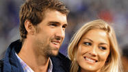 Michael Phelps, Megan Rossee break up, gossip site reports