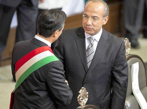 Outgoing President Felipe Calderon, right, and his successor, Enrique Peña Nieto,  shake hands during Peña Nieto's swearing-in ceremony this month in Mexico City.