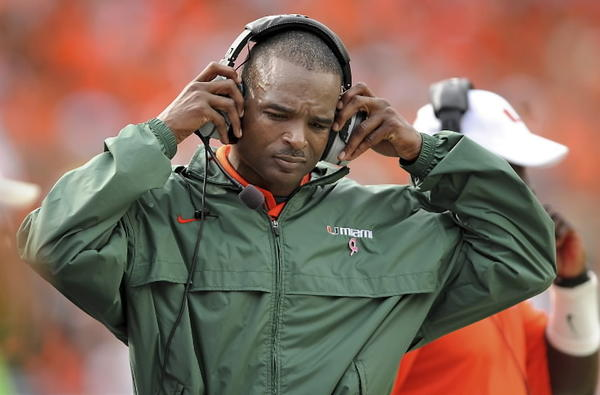 The University of Miami Hurricanes host Florida State at Dolphin stadium. Miami head coach Randy Shannon listens to his headphones during the first half.