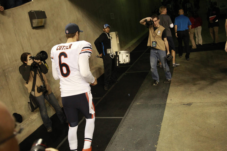 Bears quarterback Jay Cutler walks off the field at the end of his team's win over the Lions .