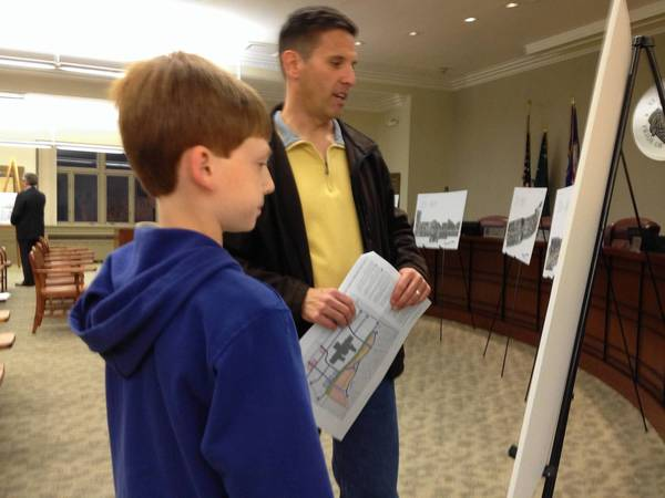 Dan Johnson of St. Charels and his son Colin examine plans for a draft of the East Gateway Plan, which includes plans for the Charlestowne Mall.