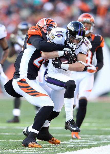 David Reed #16 of the Baltimore Ravens runs with the ball while defended by Taylor Mays #26 of the Cincinnati Bengals during the NFL gameat Paul Brown Stadium on December 30, 2012 in Cincinnati, Ohio. Cincinnati won 23–17.