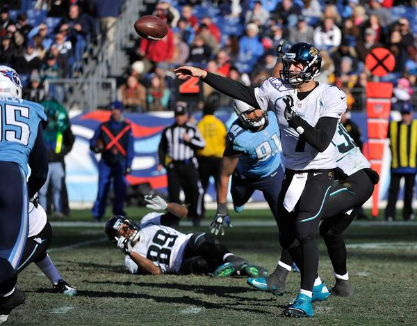 Quarterback Chad Henne #7 of the Jacksonville Jaguars throws an interception against the Tennessee Titans at LP Field on December 30, 2012 in Nashville, Tennessee. Tennessee won 38–20.