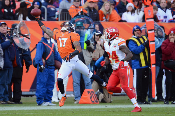Andre Caldwell #17 of the Denver Broncos reaches out for a pass against Brandon Flowers #24 of the Kansas City Chiefs during the game at Sports Authority Field at Mile High on December 30, 2012 in Denver, Colorado. Denver won 38–3.