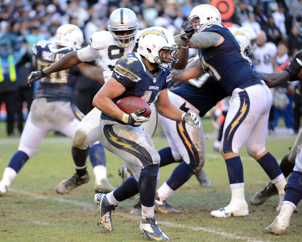Jackie Battle #44 of the San Diego Chargers carries the ball during a 24–21 win over the Oakland Raiders at Qualcomm Stadium on December 30, 2012 in San Diego, California.