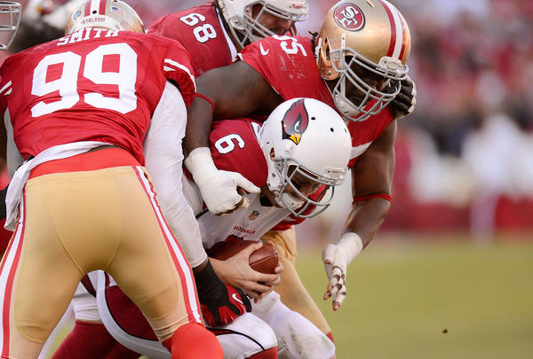 Brian Hoyer #6 of the Arizona Cardinals gets sacked by Ricky Jean Francois #95 and Aldon Smith #99 of the San Francisco 49ers in the third quarter at Candlestick Park on December 30, 2012 in San Francisco, California. The 49ers won the game 27–13.