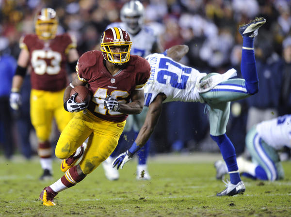 Washington Redskins running back Alfred Morris (46) gets away from Dallas Cowboys strong safety Eric Frampton (27) during the second half Sunday in Landover, Md. The Redskins won 28-18.