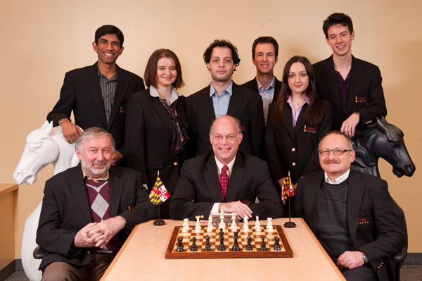 Shown is the UMBC chess team, clockwise from top left: Adithya Balasubramanian, Sabina Foisor, Giorgi Margvelashvili, Sasha Kaplan, Nazi Paikidze, Niclas Huschenbeth, coach Igor Epshteyn, director Alan Sherman and associate director Sam Palatnik.