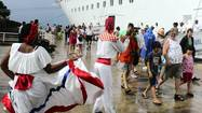 Cruise ship passengers are greeted by local dancers at La Romana in the Dominican Republic.