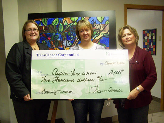 Kay Braaten, center, an associate with Northern Border Pipeline, operated by TransCanada Corp, recently gave a check for $2,000 to Jennifer Gray, executive director of Aspire, left, and Patti Marshall, development director of the Aspire Foundation, right. The grant is for the continued support of the Creative Expressions and educational programs supporting adults with developmental disabilities at Aspire Inc.