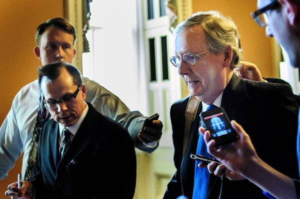 "Reporters surround Senate Minority Leader Mitch McConnell (R-Ky.) as he walks through the Capitol during a seesaw day of talks over averting a ""fiscal cliff"" by a New Year's Eve deadline."