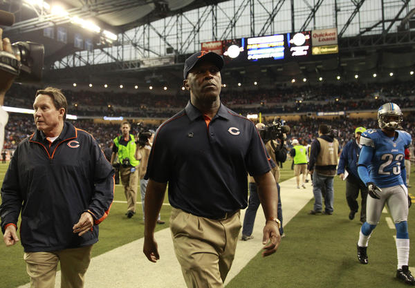 Lovie Smith walks off the field after his teams' win  over the Lions at Ford Field.