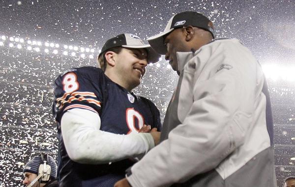 Rex Grossman and coach Lovie Smith celebrate after the Bears beat the Saints 39-14 during the NFC Championship Game.