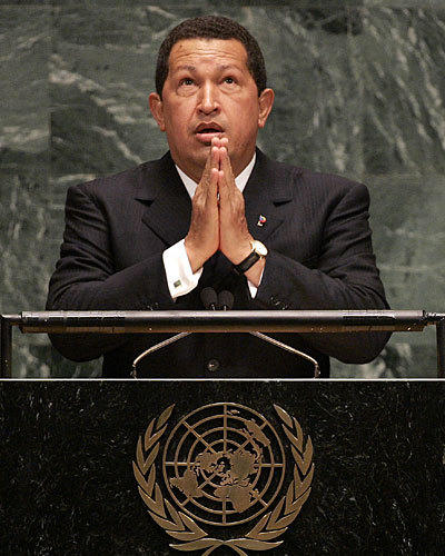 "Chavez makes a gesture of prayer as he speaks of President George W. Bush, whom he referred to as ""the devil"" during his address to the 61st session of the U.N. General Assembly in New York in September 2006. ""Yesterday, the devil came here,"" he said of Bush, who was there give a speech. ""And it smells of sulfur still today."""