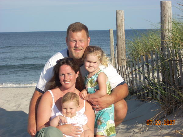 A family photo of Rob Novak with his wife Sage and their two daughters.