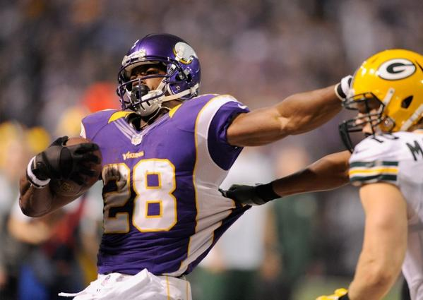 Adrian Peterson carries the ball during the third quarter on Sunday.