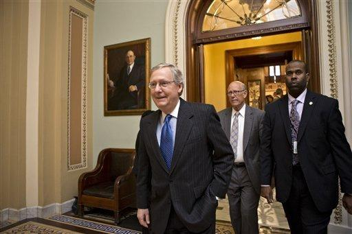 "Senate Minority Leader Mitch McConnell, R-Ky., followed by Sen. Pat Roberts, R-Kan., second from right, leaves the Senate chamber to meet with fellow Republicans in a closed-door session as the ""fiscal cliff"" negotiations continue at the Capitol in Washington on Sunday."
