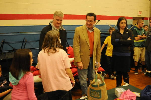 Gov. Dannel P. Malloy, at center, talks to Patricia Burns, of Thompsonville at the John F. Kennedy Middle School emergency storm shelter where she and her family have been staying. Her two children are Thomas, 9, left, and Gabrielle, 10, second from left. With the governor is JFK principal Tim Van Tasel.
